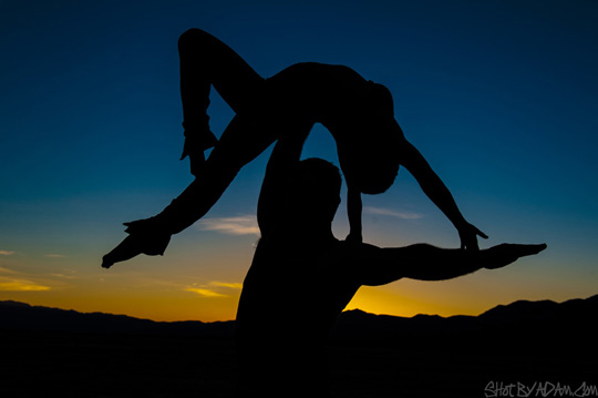 Aaron Crippen lifts acrobat Manya Silver high into the sunset at the Boulder City Dry Lake Bed