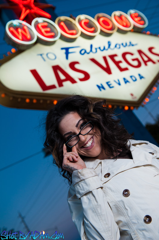 "Out at the Welcome to Las Vegas sign with model Olivia Black. She told me on our shoot that she's usually asked by photographers to give a ""sexy"" face when, in fact, she really has a great smile. I totally agree!"