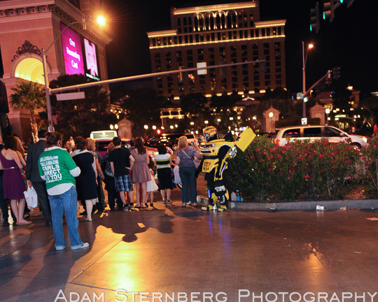 Here, this street performer in a Transformers Bumble Bee costume looks amazing and is in a prime location near the Planet Hollywood/Bellagio crosswalk but he just stands there hoping to get work. Thousands of people will walk by him in any given hour but it's rare that I've seen anyone give him a second glance.