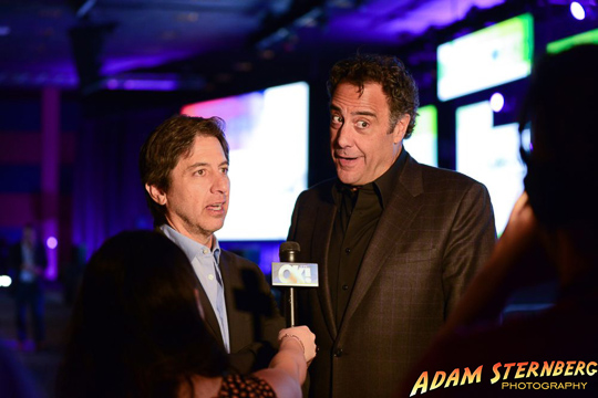 Photo of Ray Romano and Brad Garrett during an interview.