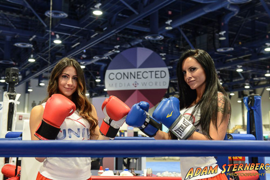 Two girls representing the University of Nevada, Las Vegas duke it out in a boxing ring.