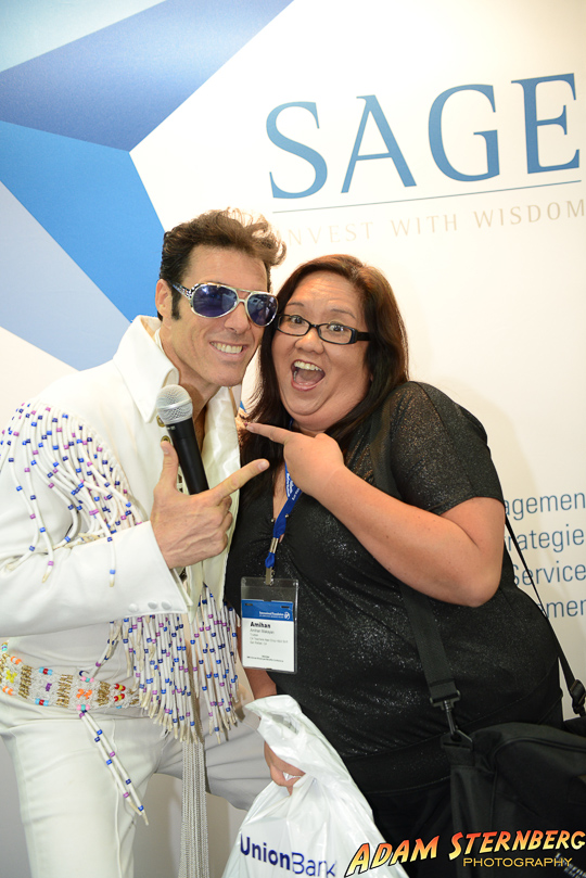 "Photos of ""Elvis"" and attendees in the Sage Advisory Services booth at a recent financial expo."