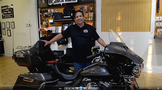Screen shot from an EagleRider orientation video of a Harley Davidson Electraglide.